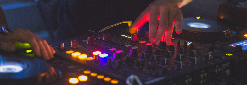 DJs technology to create a vibe and mix music together